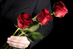 Man with red roses royalty free stock image