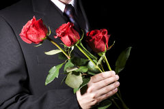 Man with red roses Royalty Free Stock Images