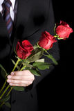 Man with red roses Stock Photography