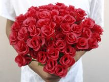 A man with red roses and valentine in the hands. Valentine day love beautiful Stock Image