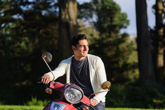 Man with red scooter Royalty Free Stock Photos