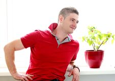 Man in red shirt is happy on this sunny day Royalty Free Stock Photos
