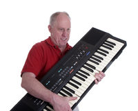 Man in Red Shirt with Keyboard Stock Images