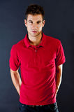 Man in the red shirt polo look at the camera Stock Photos