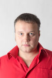 Man in a red shirt Stock Photography
