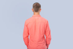 Man in red shirt turned a back Stock Photography