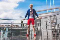 man in red shorts posing near railings Stock Photography
