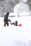 Man with Red Snow Blower Royalty Free Stock Images