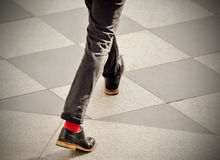 Man with red socks. Man taking the step. On nice sidewalk Stock Photos