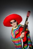 Man in red sombrero playing guitar Royalty Free Stock Photos