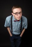 Man in a red suit and a bow tie plaid shirt on a black background Royalty Free Stock Image