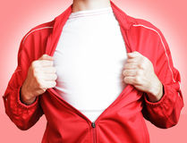 Man in a red sweater. Man pulling open shirt showing white t shirt Royalty Free Stock Photography
