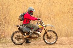 Man in Red Sweater Driving Dirt Bike Royalty Free Stock Image
