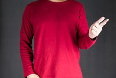 Man in red t-shirt points his finger Stock Photo