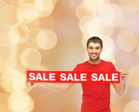 Man in red t-shirt with sale sign Royalty Free Stock Images