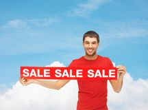 Man in red t-shirt with sale sign Stock Images