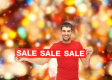 Man in red t-shirt with sale sign Stock Image