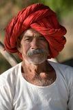 Man in red turban. Farmer in red turban in Narlai, India Royalty Free Stock Image