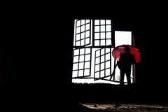 Man with red umbrella Royalty Free Stock Images
