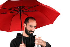Man with red umbrella Stock Photo