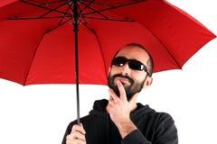 Man with red umbrella Stock Photos