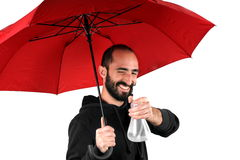 Man with red umbrella Royalty Free Stock Image