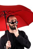 Man with red umbrella Stock Photography
