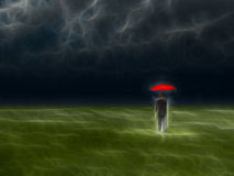 Man with red umbrella under storm Stock Images