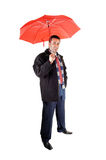 Man with red umbrella. Stock Image