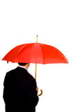 Man with red umbrells Stock Image