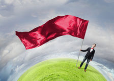 Man with red waving flag Royalty Free Stock Photography