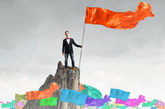 Man with red waving flag Royalty Free Stock Image