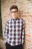 Man In Red And White Plaid Dress Shirt And Black Bottoms With Black Frame Eyeglasses stock photography
