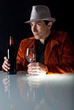 Man with red wine and empty glass Royalty Free Stock Image