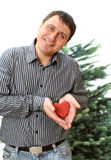 The man with the red wooden heart in the palms Stock Photos