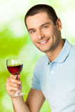 Man with redwine. Smiling man with red wine, outdoors Stock Photography