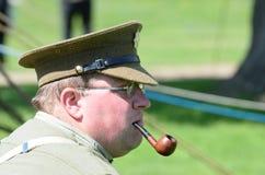 Man in reenactment uniform enjoying a pipe Stock Image
