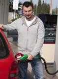 Man Refilling Car Stock Photo