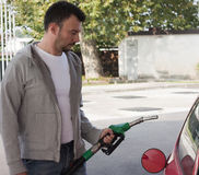 Man Refilling Car Stock Image