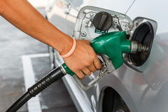 Man refilling the car with fuel on a filling stati. On stock photos