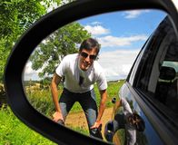 Man reflected in car mirror Stock Photography
