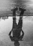 The man reflection in the water after raining.  Royalty Free Stock Photography