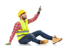 Man in reflective clothing pointing up Stock Image