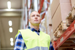Man in reflective safety vest at warehouse Stock Photos