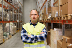 Man in reflective safety vest at warehouse Stock Images