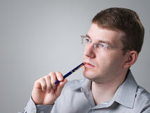 Man in reflexion. Portrait of adult man with pen Royalty Free Stock Image