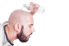 Man refreshing or cooling his head with cold water Royalty Free Stock Image