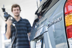 Man Refueling Blurred Hybrid Car Royalty Free Stock Photo