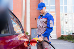 Man Refueling Car`s Tank. By Holding Petrol Pump Nozzle Royalty Free Stock Photography
