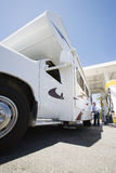 Man Refueling RV Stock Photography